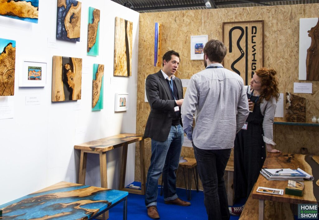 exhibitors talking at wood and epoxy design stand