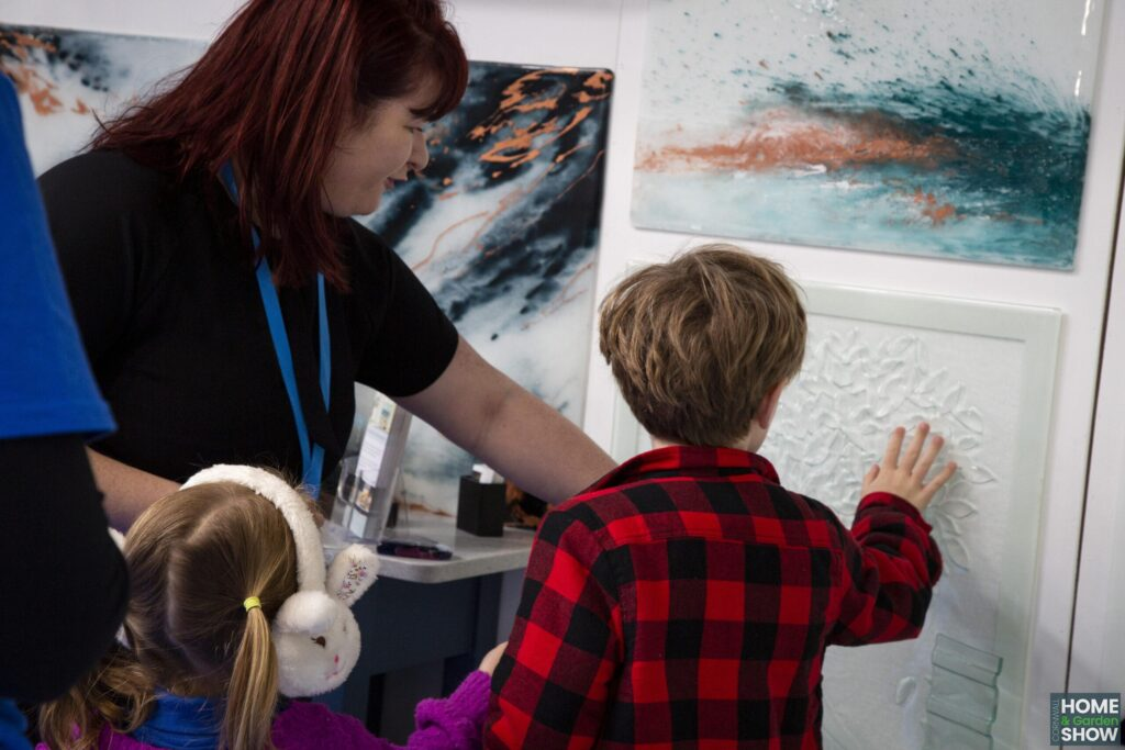children touching printed wall art concession