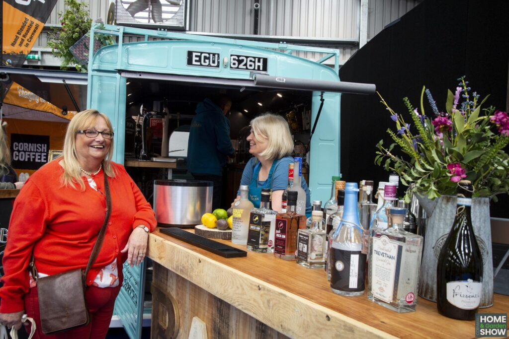 Happy customer and food exhibitor at A Bite of Cornwall Food & Drink Market