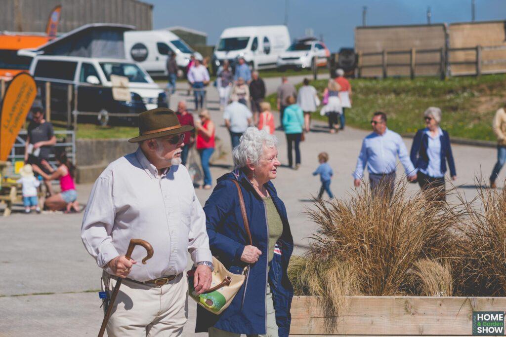 elderly couple walking in the sun