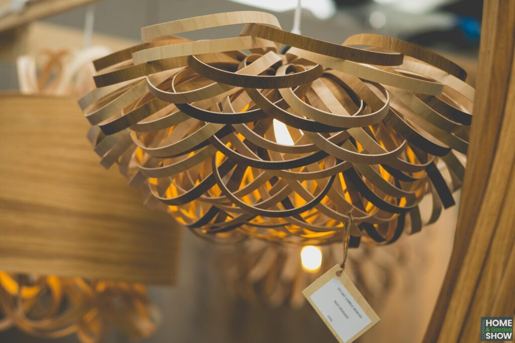 creative art deco wooden sculpted warm light shade, showing lighting solutions at Cornwall Home & Garden Show