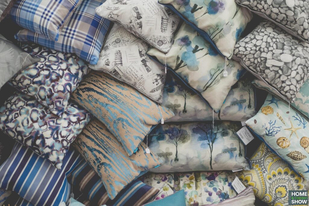 pile of decorative patterned cushions in blue and yellow at the Cornwall Home & Garden Show