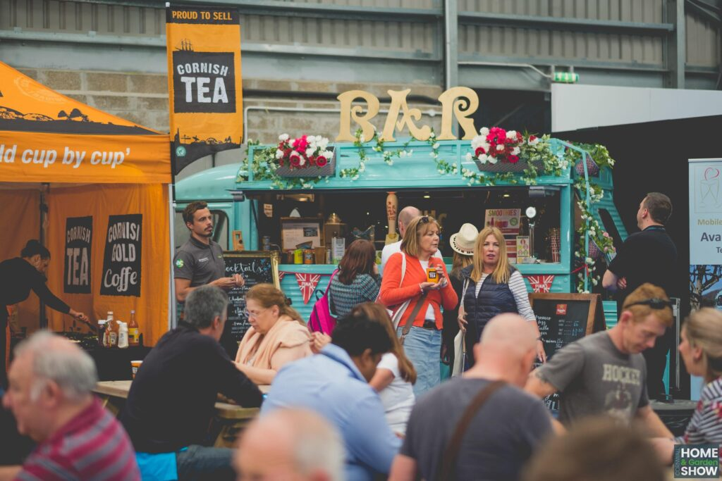 cornish tea and bar food and drinks van with seated crowd